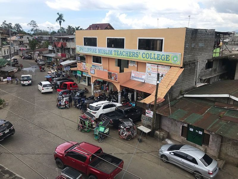 MARAWI. Two buildings of the Philippine Muslim Teachers' College on Sarimanok Avenue are sitting on land that has been declared a military reservation way back during the American occupation of the Philippines. (Photo by Luz Rimban)