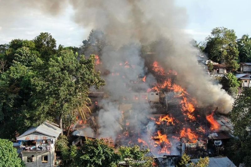 CAGAYAN DE ORO. A fire with thick smoke is seen devouring houses from an uphill view in Barangay Nazareth, Cagayan de Oro City, Monday, October 21. The Nazareth fire displaces 47 families. (Photo courtesy of BFP Special Rescue Unit-10)