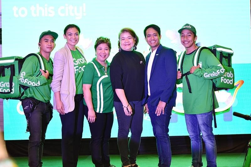 (L-R) GrabFood Delivery-Partner, Trish Avondo, Grab Ph expansion manager, Jo-An Yoshida, Grab regional operations manager, EJ dela Vega, GrabFood Ph head.