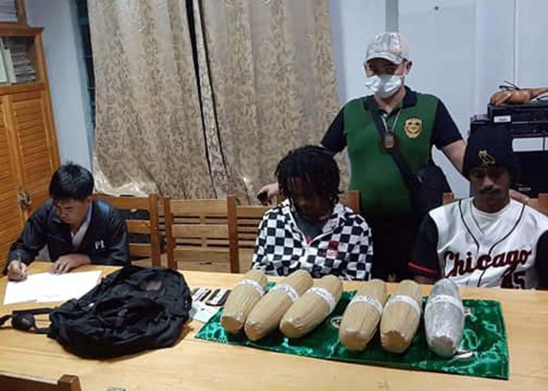 FOREIGN MULES. Authorities conduct an inventory of the dried marijuana leaves confiscated from two foreign nationals in Ifugao Province. (PDEA photo)