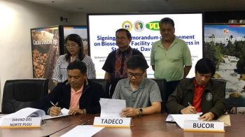 DAVAO. Davao del Norte Governor Edwin Jubahib, Tadeco AVP for human resource Zeaus Vadil, and Bucor director Gerald Bantag signed a MOA on October 22, 2019, preserving the biosecurity facilities around the banana plantation while maintaining the accessibility of the contested roads for the public. (Roberto A. Gumba Jr.)