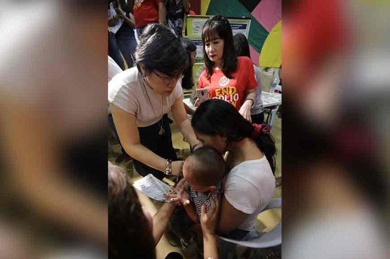 PAMPANGA. A child gets anti-polio vaccine during the end polio campaign and vaccination at Heroes Hall on Thursday. (Photo by CSF-CIO)