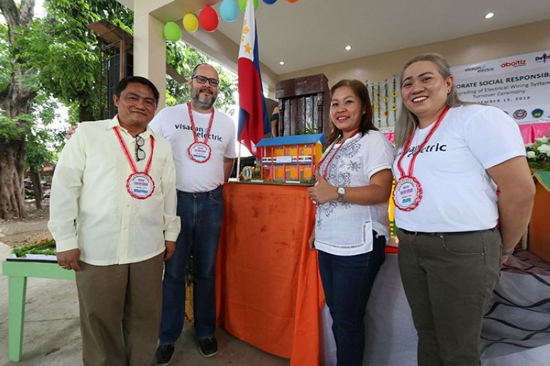 CEBU. Visayan Electric Company rewired a total of 16 schools in its franchise area this year to advance its advocacy of ensuring that schools are safe and conducive to learning. Shown in photo are (L-R) Cebu City Schools Division Superintendent Dr. Bianito Dagatan, Visayan Electric COO Anton Mari Perdices, Pamutan Integrated School Principal Amorganda Rago and Visayan Electric Reputation Manager Quennie Bronce during the turnover of the projects to Cebu City Schools. (Contributed photo)
