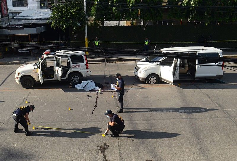 AMBUSH IN BROAD DAYLIGHT. Scene of Crime Operation (Soco) operatives gather evidence where the fatal ambush of Clarin, Misamis Occidental Mayor David Navarro happened at 2 p.m. Friday, Oct. 25, 2019 on M. Velez St., Cebu City. Four men toting long firearms pulled the mayor out of the Mahindra police car he was in and shot him point blank. Wearing a bulletproof vest, Navarro was seated between the police chief of Clarin town and Navarro's sister in the row seat behind the driver. Three other persons were injured—the driver of the Starex van that carried friends and relatives of Navarro, a passenger of the van, and Navarro's sister who was riding with him in the Mahindra. (SunStar Photo/Alan Tangcawan)