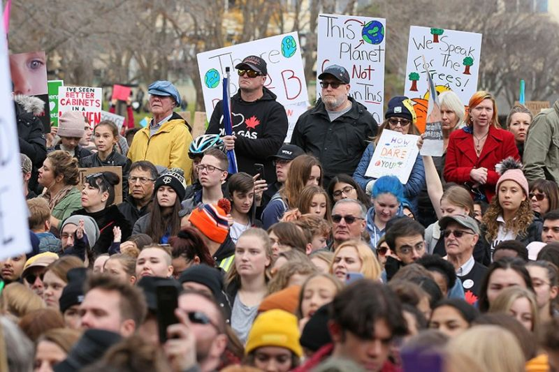 CANADA. Climate change activists gather for a march and rally with Swedish climate activist Greta Thunberg at the Alberta Legislature Building in Edmonton, Alberta, on Friday, October 18. (AP)