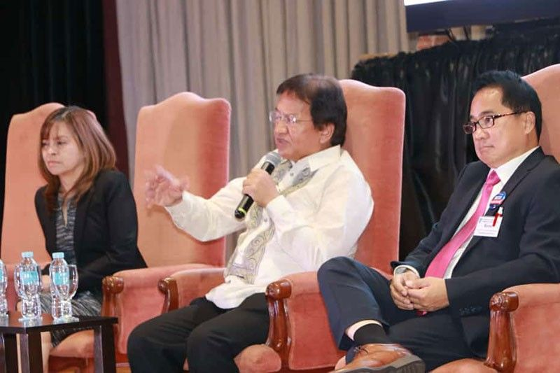 "Dr. Cielito F. Habito, director general of NEDA and concurrent socio-economic planning secretary together with PamCham President Rene Romero and MACCII President Myra Rivera during the economic briefing ""Central Luzon Amidst the Golden Age of Infrastructure"", marking the first tri-chamber membership meeting and induction of new members held at LausGroup Event Centre. (Photo by Chris Navarro)"