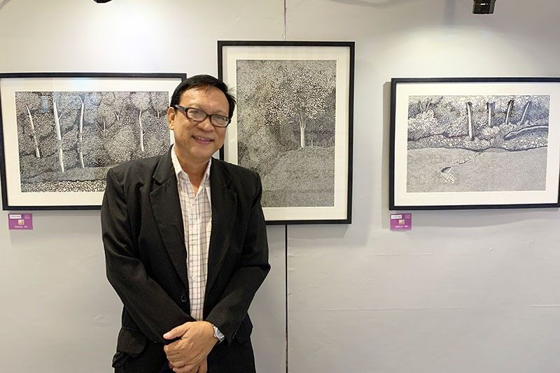 Arnel Villegas and his Forest Images. (Photo by Jinggoy I. Salvador)