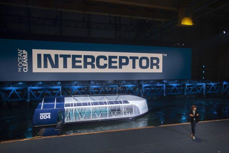 THE NETHERLANDS. Young Dutch inventor Boyan Slat, right, unveils the Interceptor in Rotterdam, Netherlands, Saturday, October 26, 2019. Slat is taking his effort to clean up floating plastic from the Pacific Ocean to rivers, using the Interceptor, a new floating device to catch garbage before it reaches the seas. (AP)