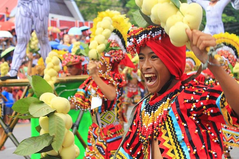 CAMIGUIN. With smiles, colorful costumes and vibrant energy, the locals dance to celebrate the bounty of Camiguin's sweet and juicy fruit, lanzones. Eight contingents compete in this year's Street Dance Competition of Lanzones Festival on Saturday, October 26, in Camiguin.  (Photo by Jo Ann Sablad)