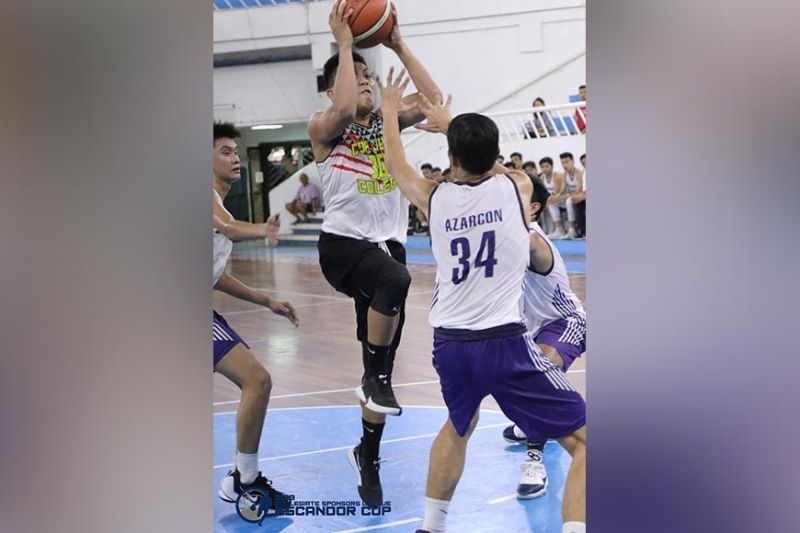 VERY TIGHT DEFENSE. Lean Jeff Doromal of Cor Jesu College of Digos goes up against three San Pedro College defenders during their 2019 Collegiate Sponsors League Escandor Cup game held October 26 at Almendras Gym Davao City Recreation Center. (Escandor Cup photo)