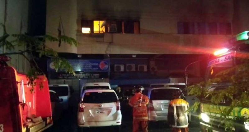 ON FIRE. Firefighters try to put out the flames that hit the second floor of the Land Transportation Franchising and Regulatory Board 7 office in Cebu City past 12 a.m. Sunday, Oct. 27, 2019. (SUNSTAR FOTO / BENJIE TALISIC)