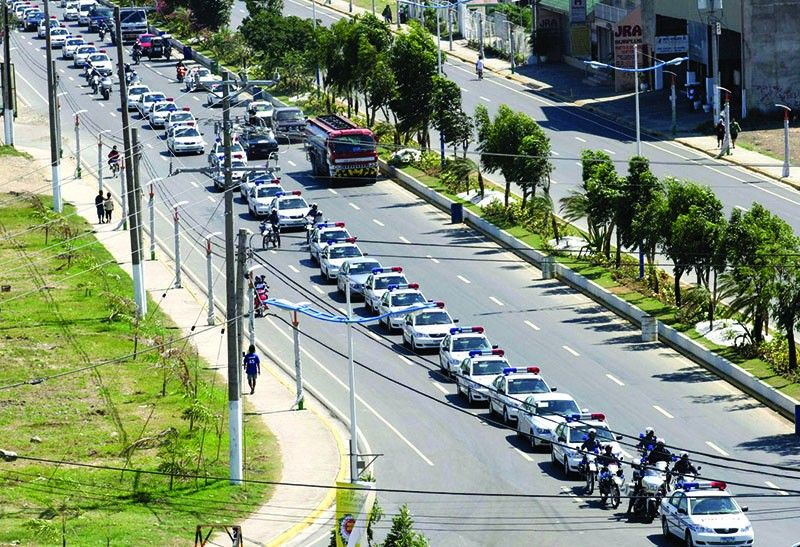"In this photo taken on December 2, 2006, Mandaue City simulates convoy of vehicles carrying ""Asean delegates"". The lampposts are on the sidewalk. (File Photo)"