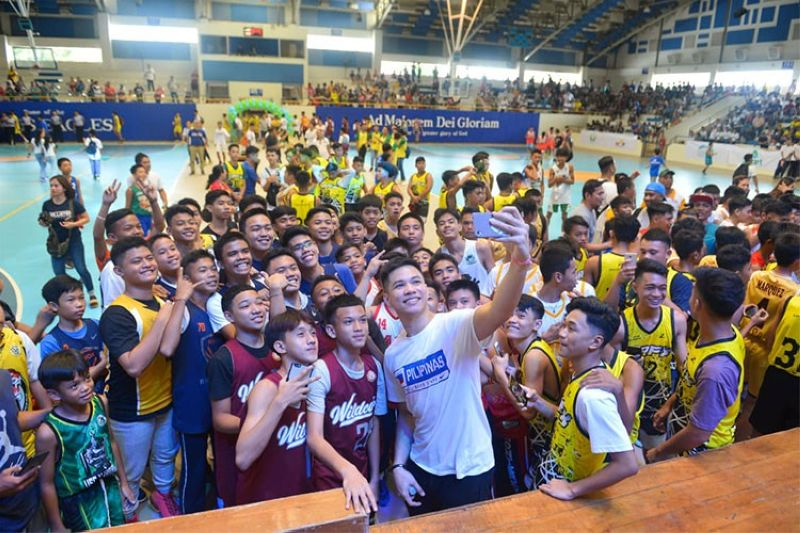 CEBU. Talk N Text and Gilas standout Roger Ray Rogoy gets mobbed for photo requests by players during the MVPSF Youth Basketball League's opening on Sunday, October 27, 2019. (Contributed photo)