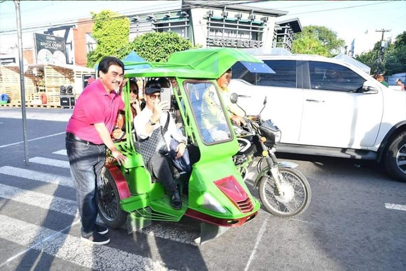 BACOLOD. Presidential Spokesperson Salvador Panelo and Mayor Evelio Leonardia ride a tricycle in Bacolod City Friday afternoon, October 25, 2019. (Contributed photo)