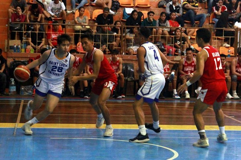 BAGUIO. Pocholo Tibayan of the Saint Louis University Navigators tries to shake off a University of Baguio Cardinals defender during their October 26, 2019 game at the SLU Prince Bernhard Gym. UB drubbed SLU, 85 – 45, to stay unbeaten in the the ongoing Baguio - Benguet Educational Athletic League season 33. (Photo by Roderick Osis)