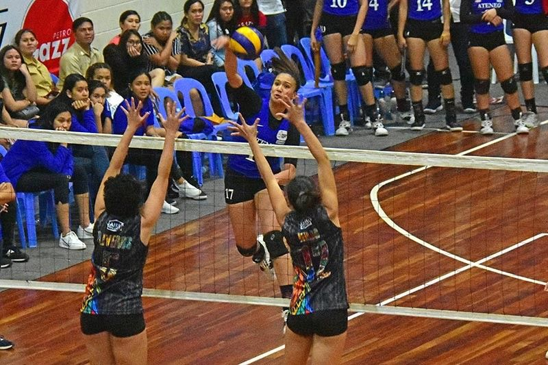 DAVAO. Dabawenya Faith Janine Shirley Nisperos of Ateneo de Manila University (Admu) Blue Eagles attacks against two Davao Optima blockers during Sunday's (October 27) charity volleyball game at Rizal Memorial Colleges (RMC) Petro Gazz Arena in Davao City. (Macky Lim)