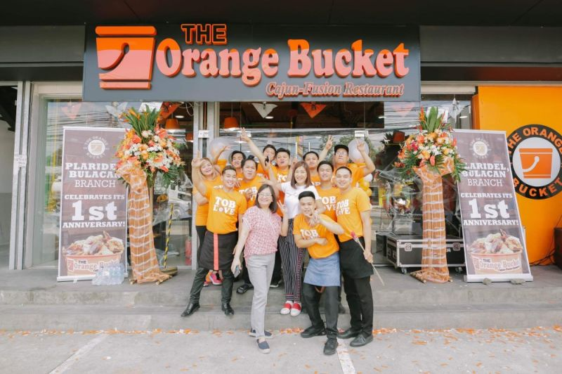 BULACAN. The Orange Bucket-Plaridel, Bulacan owners Mia Caballa and Elaine Caballa pose with the staff during the restaurant's first anniversary celebration on October 26, 2019. (Charlene Cayabyab)