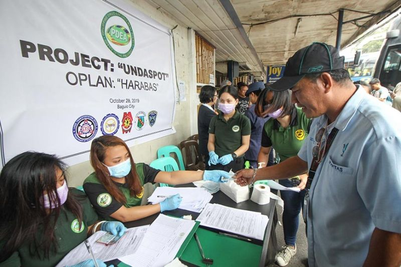"BAGUIO. A bus driver submits his urine sample to Philippine Drug Enforcement Agency (PDEA) agents during a random drug test dubbed ""Project: Undaspot"" at the Gov. Pack Road bus station. (Photo by Jean Nicole Cortes)"