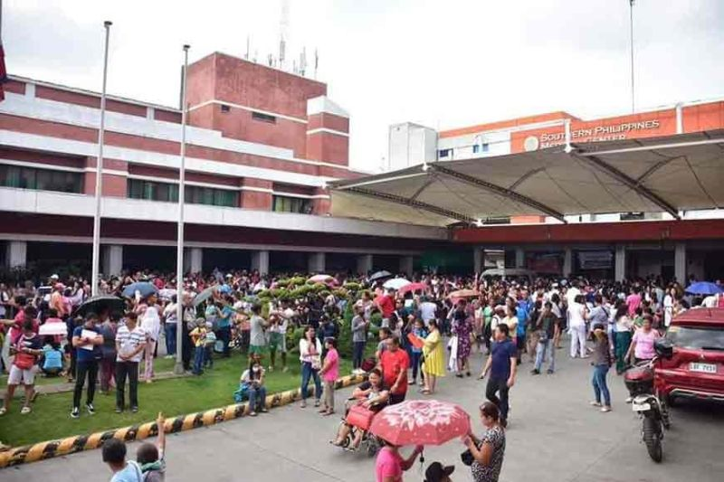 DAVAO. Patients, visitors, employees, and the medical staff of the Southern Philippine Medical Center gather at the open space of the hospital following the magnitude 6.4 earthquake that struck Mindanao around 9 a.m. Tuesday, October 29, 2019. (Macky Lim)