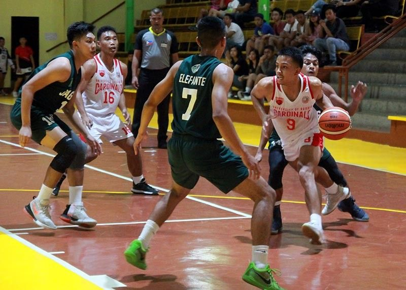 BAGUIO. Maenard Rae Razo (9) of the UB Cardinals looks to pass amid a trio of defenders from the UC Jaguars during their eliminations round match – up at the CCDC gym Sunday afternoon, October 27, 2019. The Cardinals scored another lopsided victory, 84 – 57, to extend their win streak to seven this season. (Photo by Roderick Osis)