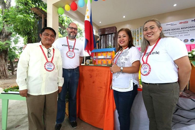 REWIRING KINDNESS. Visayan Electric Company rewired a total of 16 schools in its franchise area in 2019 to advance its advocacy of ensuring that schools are conducive to learning. In photo are (from left) Cebu City Schools Division Superintendent Bianito Dagatan, Visayan Electric chief operating officer Anton Mari Perdices, Pamutan Integrated School Principal Amorganda Rago and Visayan Electric reputation manager Quennie Bronce during the turnover of the projects to Cebu City Schools. (Contributed photo)