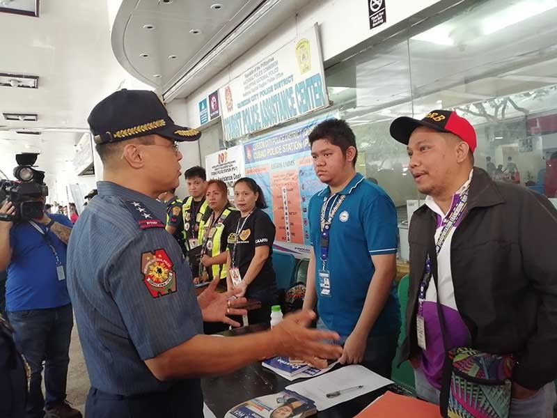 MANILA. Philippine National Police officer-in-charge Archie Gamboa talks to the personnel manning the assistance desks at the Araneta Center Bus Terminal. (Photo by Third Anne Peralta-Malonzo/SunStar Philippines)