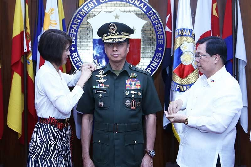 MANILA. Armed Forces of the Philippines Chief of Staff Lt. Gen. Noel Clement receives his fourth star from his wife Geraldine Anne in a donning of ranks ceremony held October 30, at the Department of National Defense. The ceremony was presided by DND Undersecretary Cardozo Luna. (Photo by TSG Obinque/PAO, AFP)