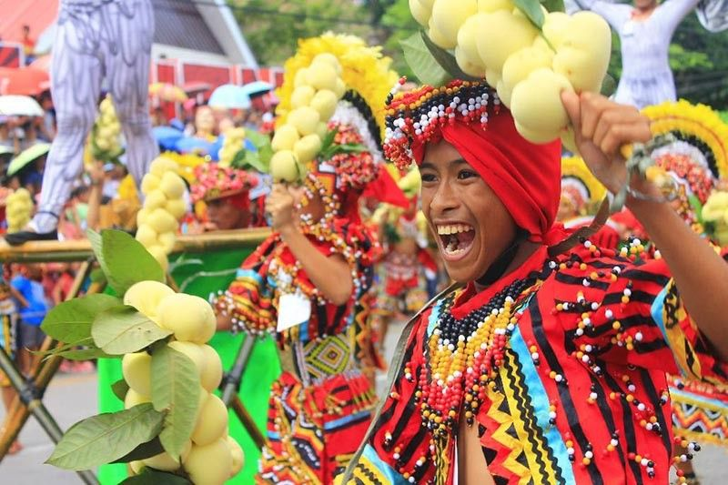 CAMIGUIN. Dancers in colorful costumes take part in the 40th Lanzones Festival. (Photo by Jo Ann Sablad)