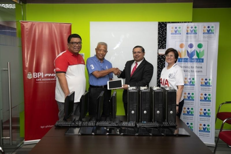 PAMPANGA. Sandiwaan Center for Learning Executive Director Fr. Benigno Beltran, SVD (second from left) receives technological equipment donations from BPLAC CEO Surendra Menon (second from right). Also present in the turnover ceremony are Philam Foundation President and CEO Max Ventura (leftmost) and Philam Life Chief Legal Officer Carla Domingo (rightmost). (Contributed photo)