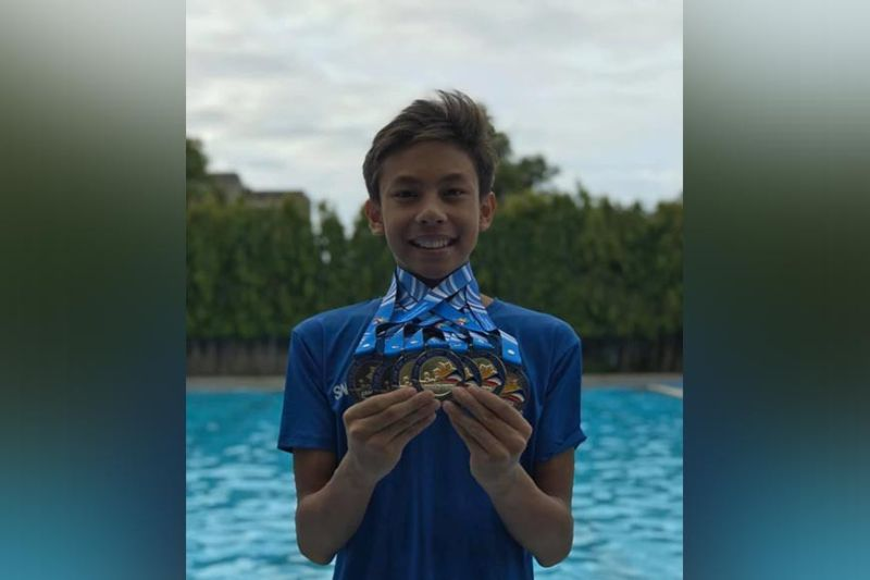 DAVAO. Ivo Nikolai Enot of Davao City's Holiday Gym Swim Club shows the gold medals and bronzes he won in the 2019 PSI SC Grand Prix National Championships age group competition at Trace College Aquatics Center in Laguna recently. (Photo from Ivo Nikolai Enot Facebook account)