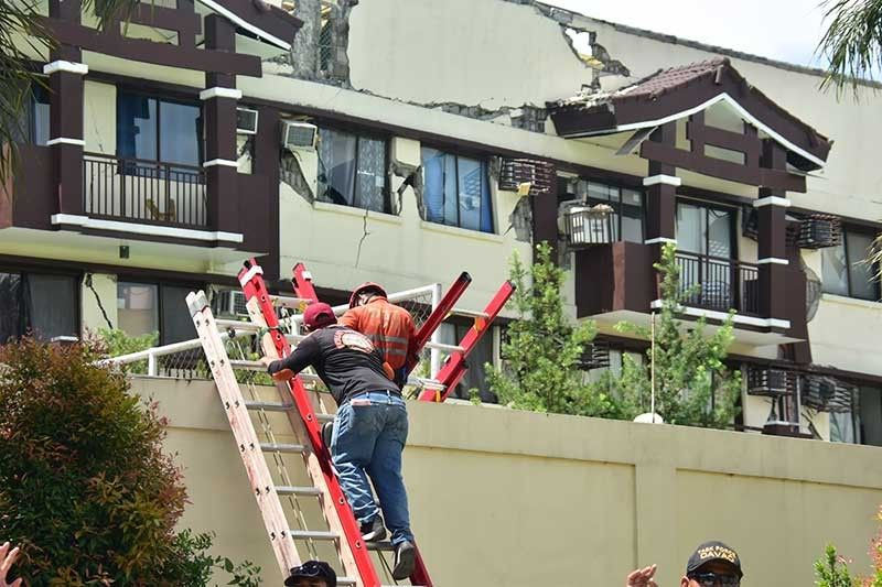 DAVAO. Emergency responders conduct search and rescue operations at the heavily damaged Ecoland 4000 condominium in Davao City after a magnitude 6.5 earthquake on October 31, 2019. (Photo by Macky Lim/SunStar Davao)