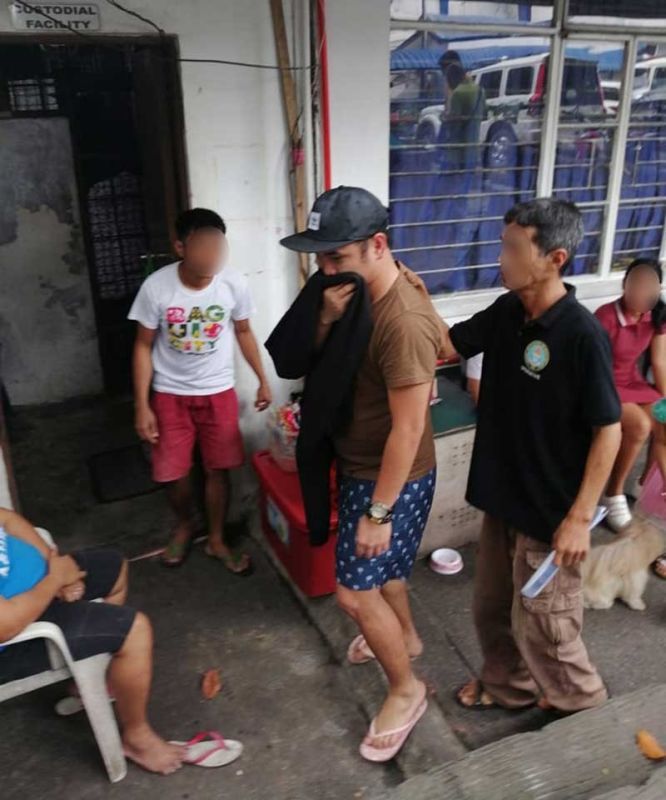 MANILA. Rigen Marketing CEO Paul Auditor (center) is being taken to the PNP Crime Laboratory in Camp Crame for a medical check-up in this photo taken on Thursday, October 31, 2019. (Photo by Third Anne Peralta-Malonzo/SunStar Philippines)