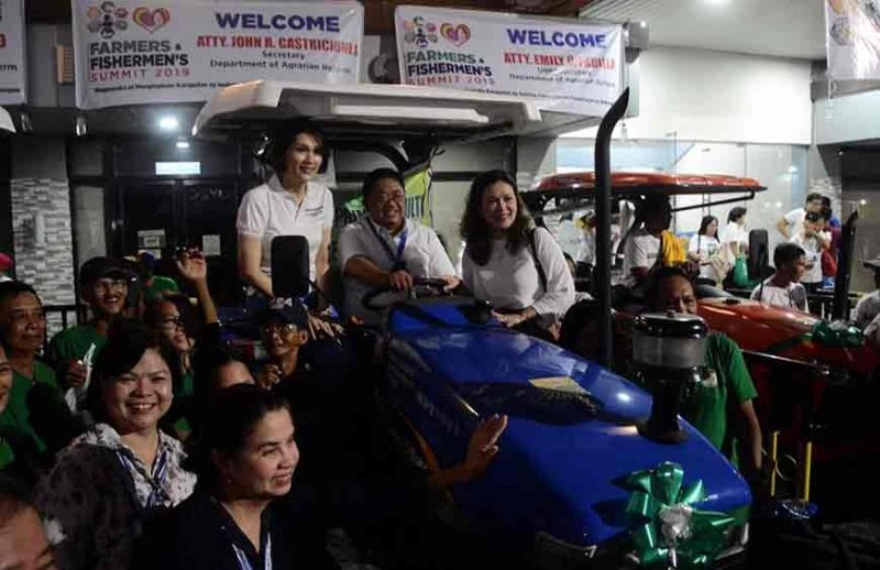 BATAAN. Agrarian Reform Secretary John Castriciones (seated middle) leads the turnover of equipment to agrarian cooperatives in Bataan during the Farmers and Fishermen's Summit 2019 organized by Office of 1st District Representative Geraldine B. Roman. (Contributed photo)