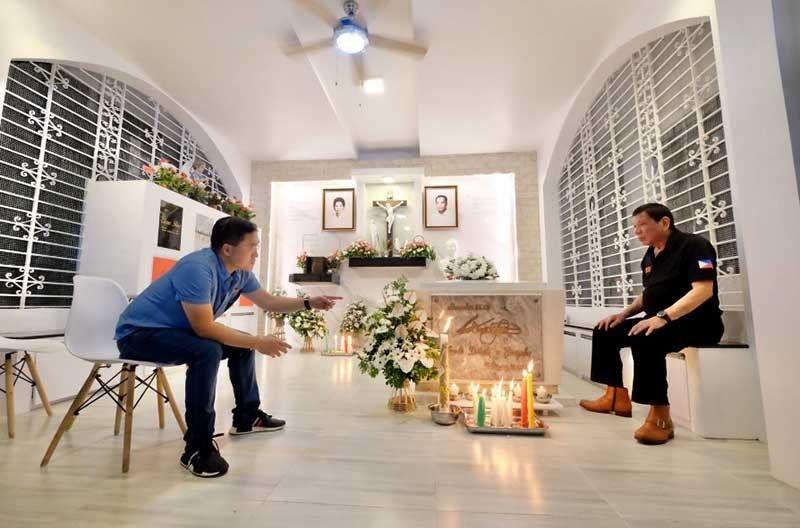 DAVAO. President Rodrigo Duterte (right) talks with former aide, Senator Christopher Go, inside the Duterte family mausoleum in Davao City on October 31, 2019. (Photo by Senator Bong Go)