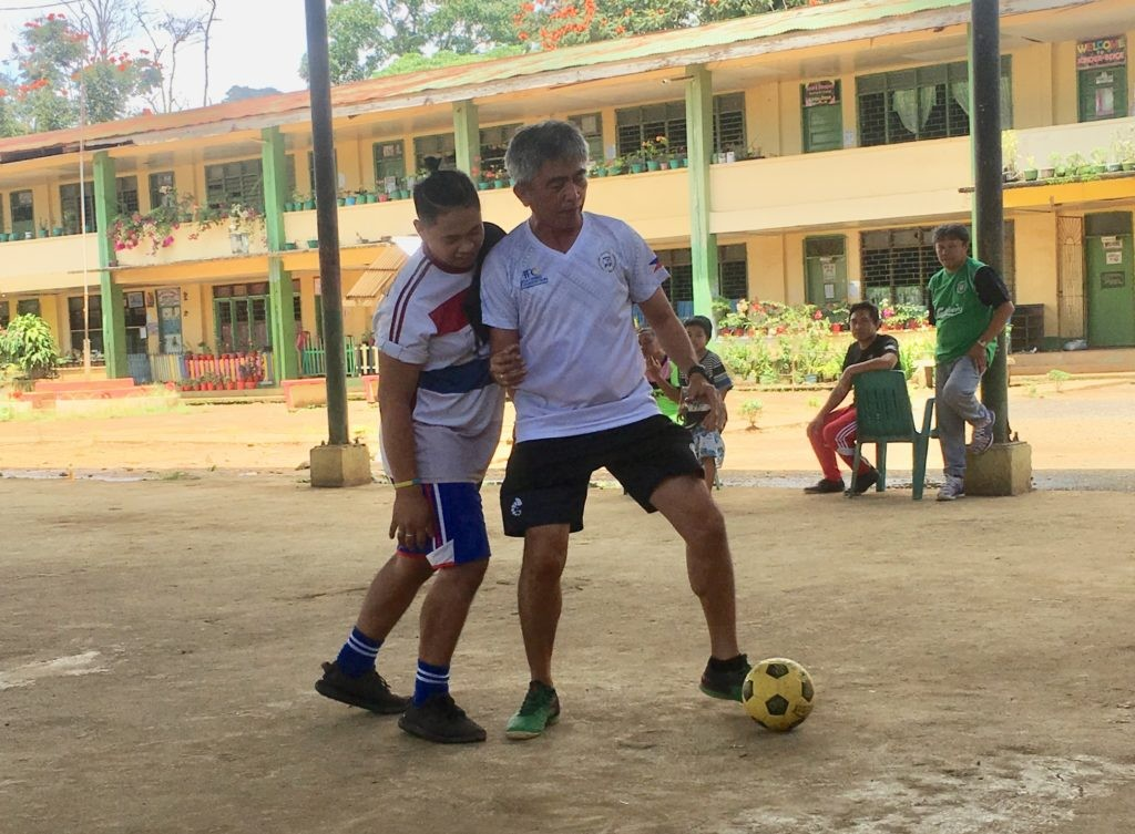 CAGAYAN DE ORO. Chief instructor Percy Guarin of Cagayan de Oro shows the teachers in Marawi how to protect the ball. (Photo by Jack Biantan)