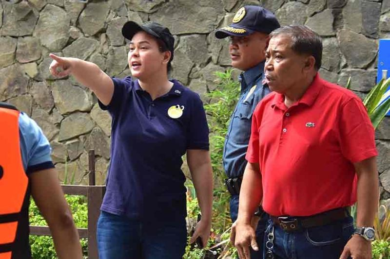 DAVAO. Davao City Mayor Sara Duterte-Carpio and Davao City Police Office Director Colonel Kirby John Kraft check the situation on the ground after a condominium along Eco West Drive in Davao City partially collapsed following a 6.5-magnitude earthquake that struck Davao City and other areas in Mindanao Thursday, October 31, 2019. (Macky Lim)