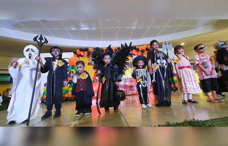 PAMPANGA. Children dressed in scary costumes participate in Thursday's