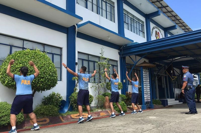ILOILO. Four police personnel from Boracay Island exercise in front of the headquarters of the Police Regional Office-Western Visayas in Camp Martin Delgado in Iloilo City on Monday, November 4, as punishment for violating the guidelines on the use of cellphones during office hours or while on duty. (Leo Solinap)
