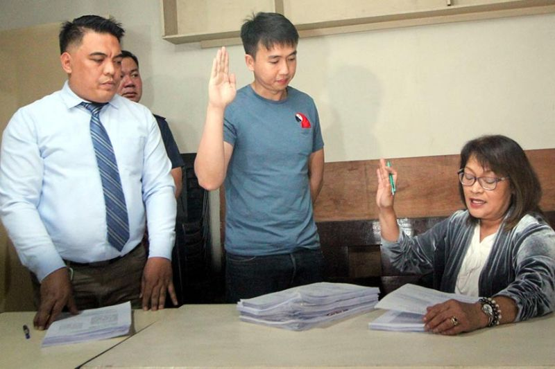 DAVAO. Together with his legal counsel lawyer Jose Adrian Bonifacio, Dexter Dormitorio, swears in front of Baguio City Prosecutor Margarita DG Manalo on Monday, November 5, 2019. Dexter, brother of hazing victim CDT 4th Class Darwin Dormitorio died on September 18, filed charges against Lieutenant General Ronnie Evangelista and Brigadier General Bartolome Vicente Bacarro at the Baguio City prosecutor's office for violation of RA 11053, RA 9745; and dereliction of duty. (Photo by Jean Nicole Cortes)