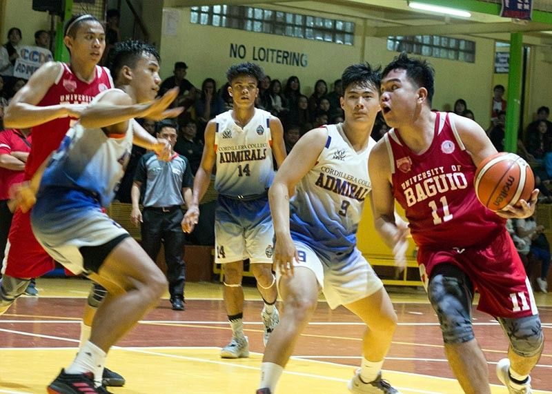 BAGUIO. University of Baguio Cardinals rookie Bheniedick Lozano goes for a drive against a sea of Cordillera Career Development College Admirals defenders Tuesday afternoon, November 5, 2019. Lozano finishes the ball game with a team high. (Jean Nicole Cortes)