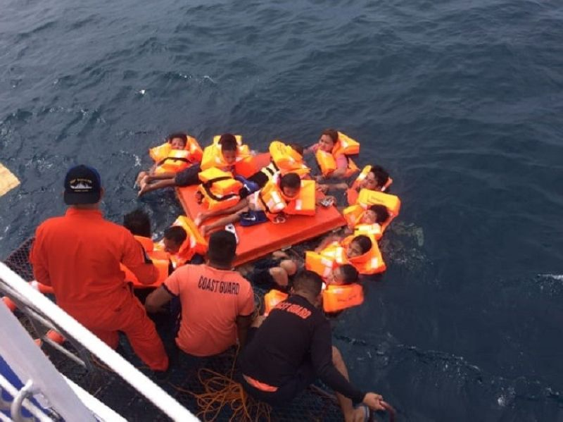 SEA ANGELS. The personnel of the Philippine Coast Guard 7 rescue the passengers of a fastcraft that sank in the waters off Sibonga town, southern Cebu on Thursday morning, Nov. 7, 2019.( Contributed Photo / Philippine Coast Guard 7  )