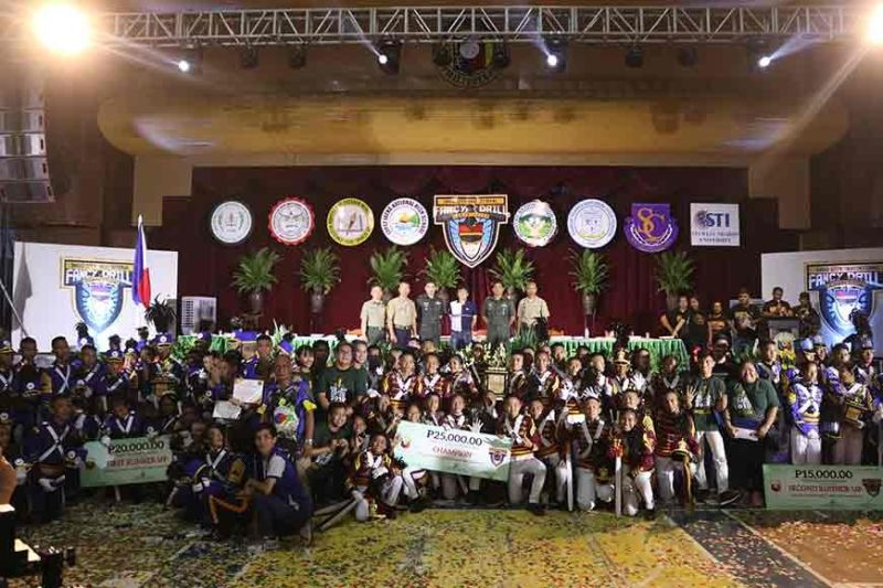 BACOLOD. The top three schools led by the champion, Enriqueta Montilla de Esteban Memorial High School of Pulupandan, with the judges from Philippine Military Academy and Vice Mayor Ramon Torres. (Contributed photo)