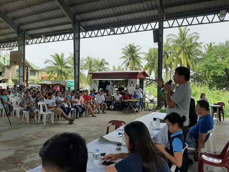 PAMPANGA. San Simon Mayor Abundio Punsalan Jr. informs African Swine Fever-affected backyard hog raisers of the zero interest loan they can avail themselves of through the Department of Agriculture. (Princess Clea Arcellaz)