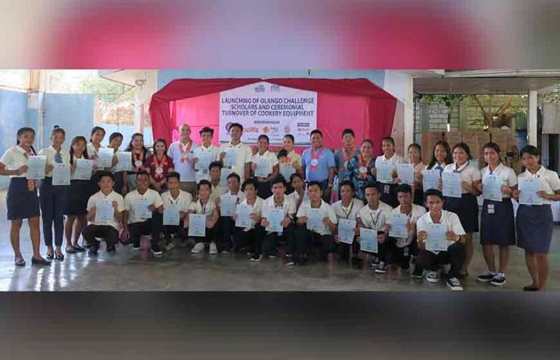 SCHOLARS. Some of the students of Sta. Rosa National High School in Olango Island, Lapu-Lapu City, Cebu City show their certificates of their being scholars of the Philippine Business for Social Progress. (Contributed Photo )
