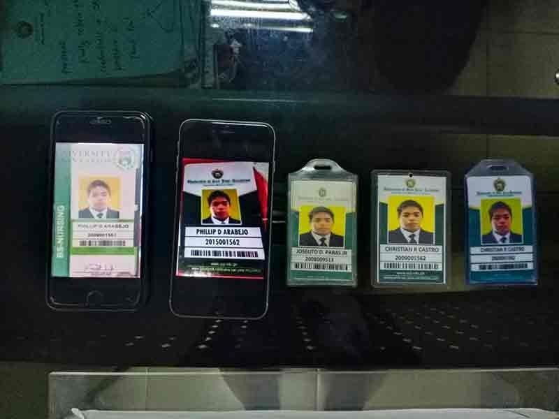 NOTICE TO THE PUBLIC. These confiscated fake school IDs of a man, later identified as Joselito dela Cerna Paras Jr., were used by Paras to scam people into thinking that he was a student of the University of San Jose-Recoletos (USJ-R) needing financial help. (Contributed Photo / USJ-R)