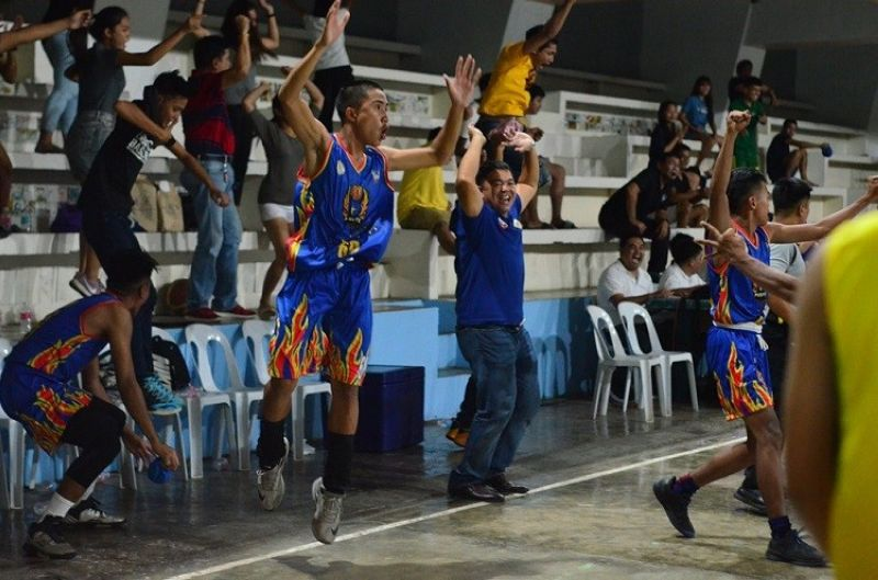 WILD CELEBRATION. Players and supporters from Cristal e-College celebrate after the final buzzer preserves their 103-102 win over Holy Name University. (Contributed Photo)