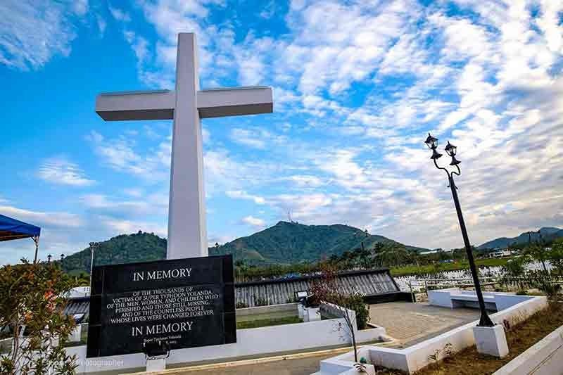 TACLOBAN. The mass gravesite in Barangay Basper, Tacloban City where storm survivors offer holy mass and wreaths for those who died during the Super Typhoon Yolanda in November 8, 2013. (Photo by Elmer Eclipse)