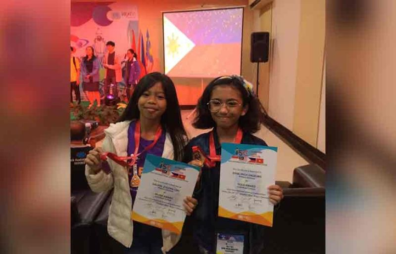 DAVAO. Zuleika Lou Dalian and Mich Angeline Emin show off their silver and gold medals, which they won at the International Science Competition in Bogor, Indonesia. (Contributed photo)