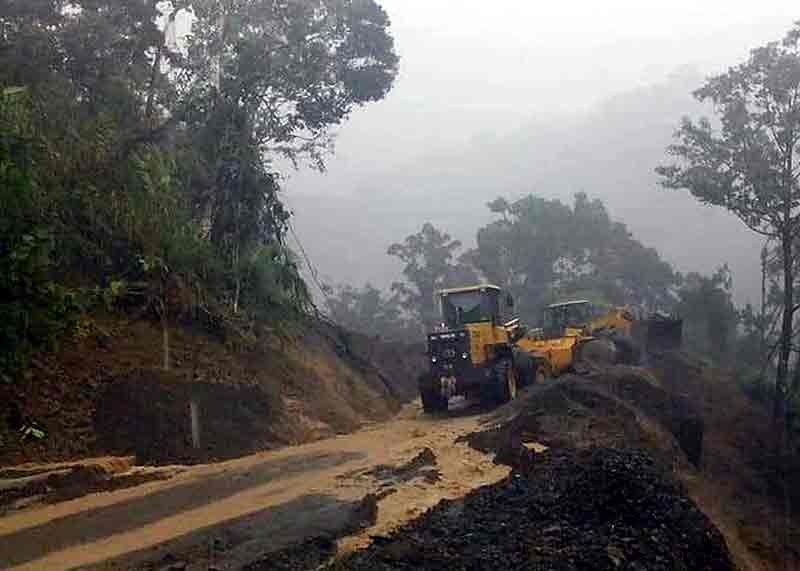 "CLEARING. Employees of Calanasan town in Apayao Province conduct clearing operations following a series of landslides which hit the town due to heavy rains caused by severe tropical storm ""Quiel."" (Calanasan MDRRMO photo)"