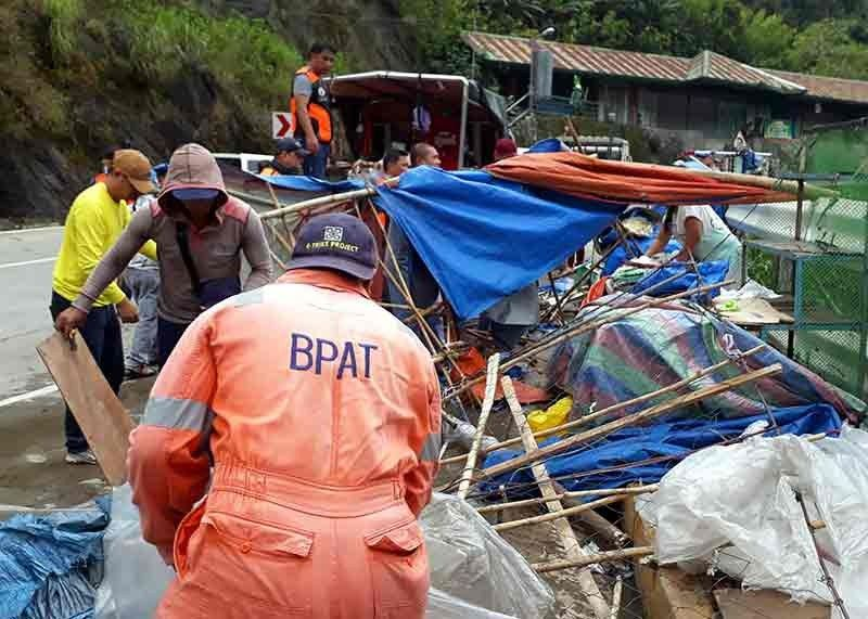 BENGUET. Twelve stalls were again demolished and items were confiscated at the right side of the iconic Lion's Head along Kennon Road on Wednesday, November 7, in an operation ordered by Mayor Benjie Magalong. The stalls had been removed several times in the past but errant vendors kept on rebuilding. Three more stalls will be removed once the demolition order is issued. (Contributed photo)